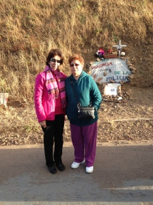 Elvira Nieto and her sister at Alex's memorial altar.