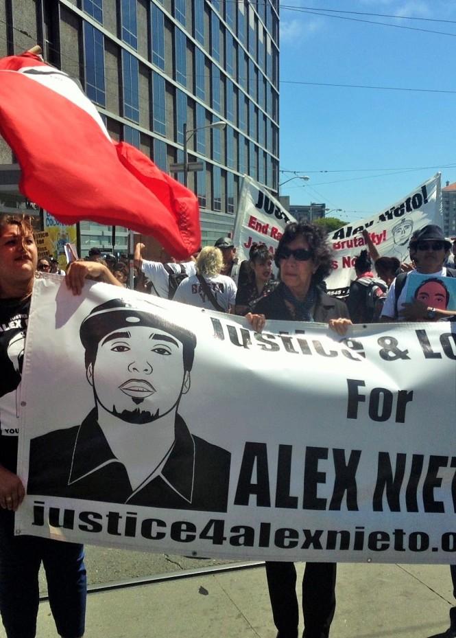 Elvira & Refugio Nieto march for their son. (Aug. 22, 2014)
