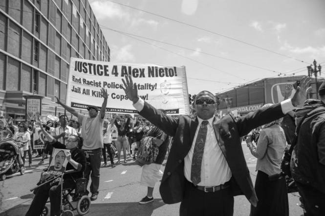 #HandsUpDontShoot Ben Bac Sierra surrenders to the Alex Rises! March for Civil Rights Against Police Killings (Aug. 22 2014) Photo: Jason Wyman