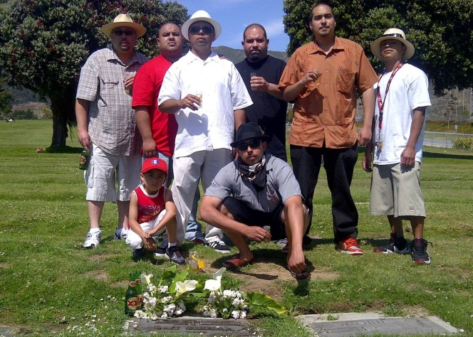 Ben with Alex and other homeboys visiting his brother's grave.